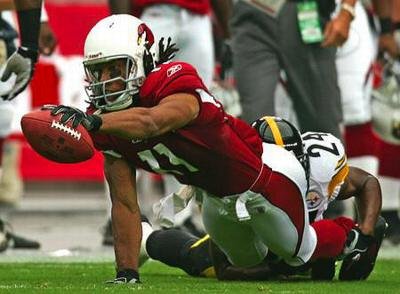 Pitt alum Larry Fitzgerald goes for a first down on the Cardinals, 8/06 via panthersinthepros