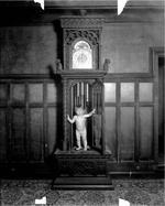 rhoads_child_stepping_out_of_clock_1916.jpg